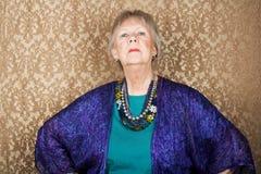 старшая snooty женщина Стоковые Изображения