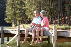 Старшее рыболовство пар совместно Стоковое фото RF