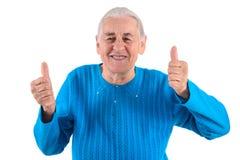Старшие большие пальцы руки женщины вверх Стоковое фото RF
