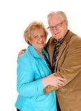 Старшие положение и обнимать пар стоковое фото