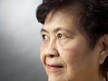 старший азиата близкий вверх по женщине Стоковая Фотография