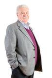 Старший бизнесмен усмехаясь на камере против белизны Стоковые Фото