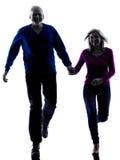 Старший пар бежать счастливый силуэт Стоковые Изображения