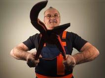 Старший работник с инструментом Стоковая Фотография
