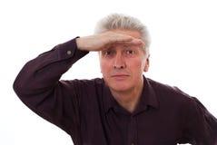Старший смотреть бизнесмена Стоковые Фото