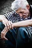 старший человека нажатия принципиальной схемы времени старый унылый Стоковое Фото