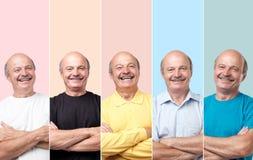 Старший человек в различных одеждах смеясь и смотря с улыбкой на камере стоковое изображение