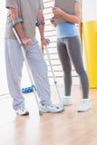Старший человек и его тренер Стоковая Фотография RF