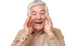 Старший японский окрик человека что-то Стоковая Фотография