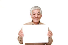 Старший японский человек с доской для сообщений Стоковые Фото