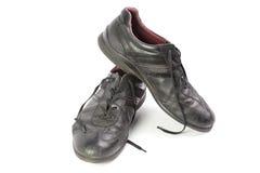 Старые ботинки при шнурки изолированные на белой предпосылке Стоковая Фотография