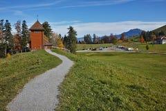 Старые деревья церков и осени близко устанавливают Rigi, Альпы Стоковые Изображения RF