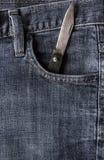 Старые джинсы карманн фронта ножа Стоковые Изображения RF