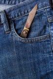 Старые джинсы карманн фронта ножа Стоковое Изображение