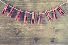Старые зажимки для белья на веревочке Стоковое Изображение RF