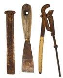 Старые изолированные инструменты: зубило, нож замазки, регулируемый ключ Стоковое Изображение