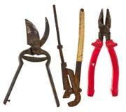 Старые изолированные инструменты: регулируемый ключ, плоскогубцы, ножницы для металла Стоковые Изображения