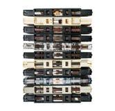 Старые и пакостные магнитофонные кассеты изолированные на белизне Стоковая Фотография RF