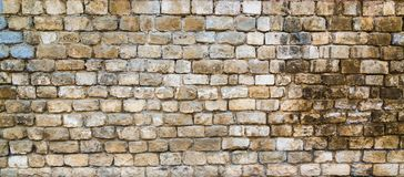 Старые каменные стены Кирпичная стена дома текстурированный серый цвет предпосылки абстракция Стоковое фото RF