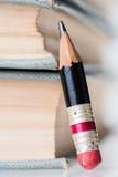 Старые книги и малый совершенный карандаш Стоковые Изображения RF