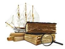 Старые книги при изолированные перечени и корабль Стоковое фото RF
