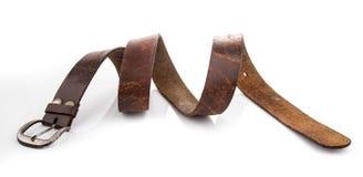 Старые кожаные поясы изолированные на белой предпосылке стоковая фотография rf