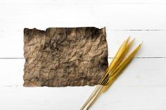Старые коричневая бумага и пшеница Стоковое Изображение RF