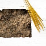 Старые коричневая бумага и пшеница Стоковая Фотография RF