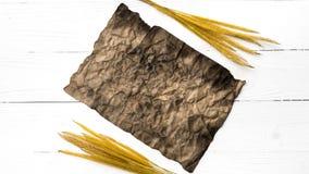 Старые коричневая бумага и пшеница Стоковое фото RF
