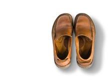 Старые коричневые кожаные ботинки ` s людей Стоковая Фотография