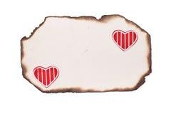 Старые, котор сгорели бумага и сердца Стоковое фото RF