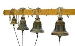 Старые колоколы на изолированной веревочке стоковые изображения