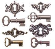 Старые ключи и keyholes Стоковое Изображение