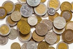 Старые монетки различных национальностей Стоковое Фото