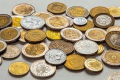 Старые монетки различных национальностей Стоковая Фотография