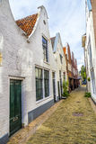 Старые дома в узкой улице Стоковые Изображения RF