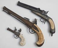 Старые пистолеты на белой предпосылке Стоковая Фотография RF