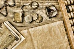 Старые примечания и монетки и абакус Стоковая Фотография RF