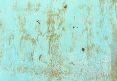 Старые ржавые шрамы красят великолепную металлопластинчатую предпосылку текстуры стоковые фото
