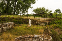 Старые руины и скульптура в Dion, Греции Стоковое Изображение