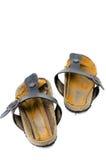 Старые сандалии над белизной Стоковые Изображения RF