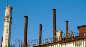 Старые трубы против неба Стоковые Фото