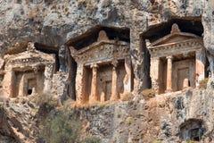 Старые усыпальницы утеса Lycian в Fethiye, Турции Стоковые Изображения
