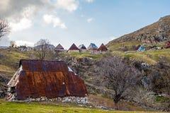 Старые хаты в горах Стоковая Фотография