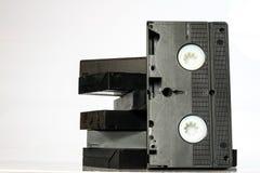 Старые хорошие видео- кассеты Пылевоздушные записи семьи на твердых данных Стоковая Фотография RF