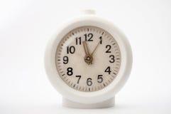 Старые часы на белой предпосылке Стоковые Изображения RF