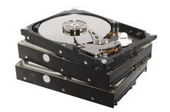 Старые штабелированные жесткие диски изолированными Стоковая Фотография