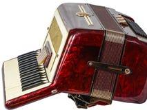 Старый аккордеон лежа на белой предпосылке стоковая фотография