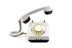 Старый белый телефон на белой предпосылке Стоковое фото RF