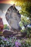 Старый Будда за предпосылкой неба 01 Стоковое фото RF